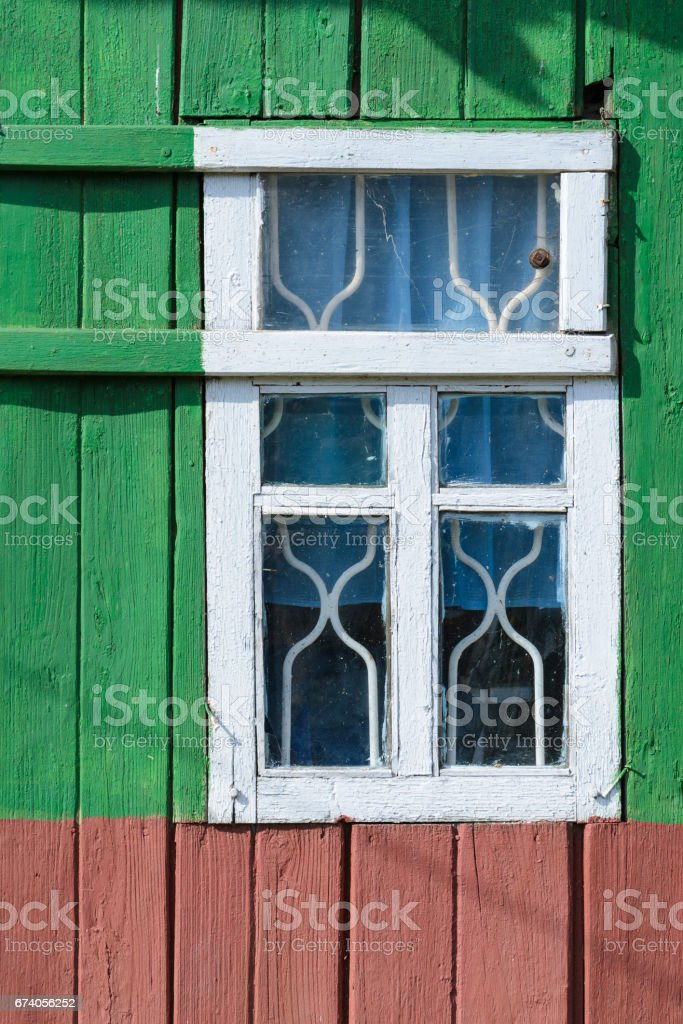 Green wooden wall with window in white frame royalty-free stock photo