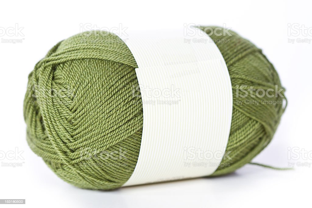green wool yarn skein at the white background royalty-free stock photo
