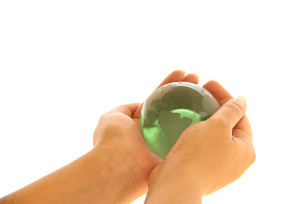 Green world in hands stock photo
