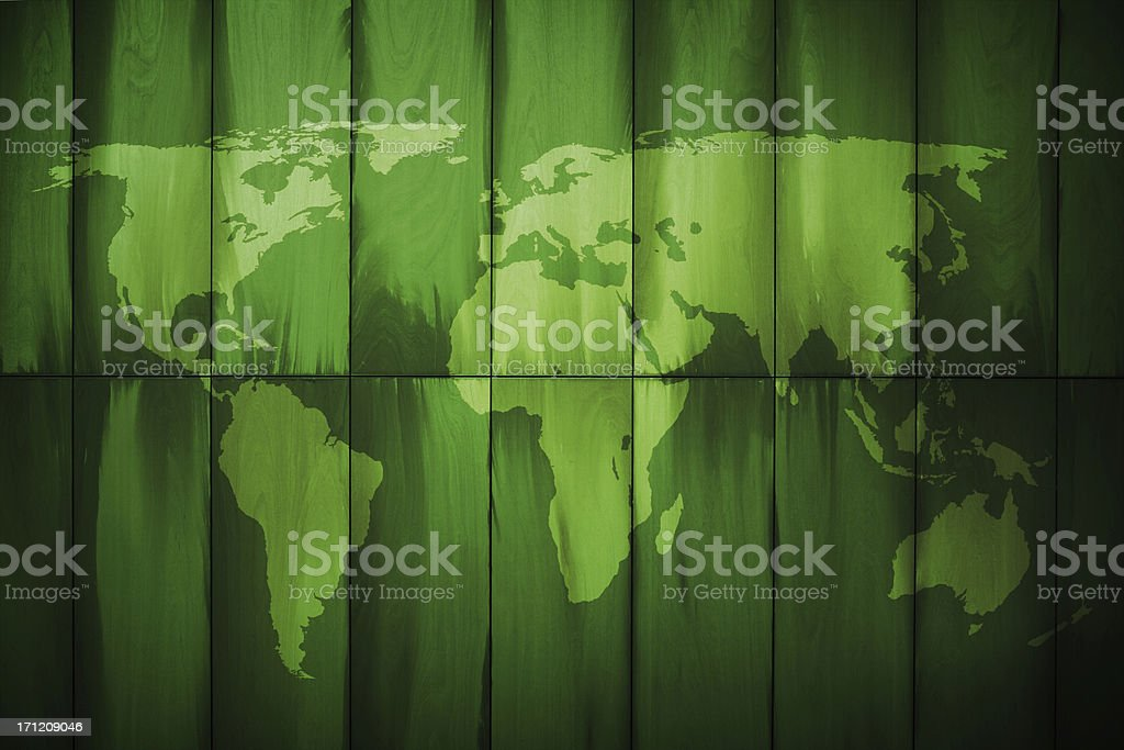 Globe map on wood texture.