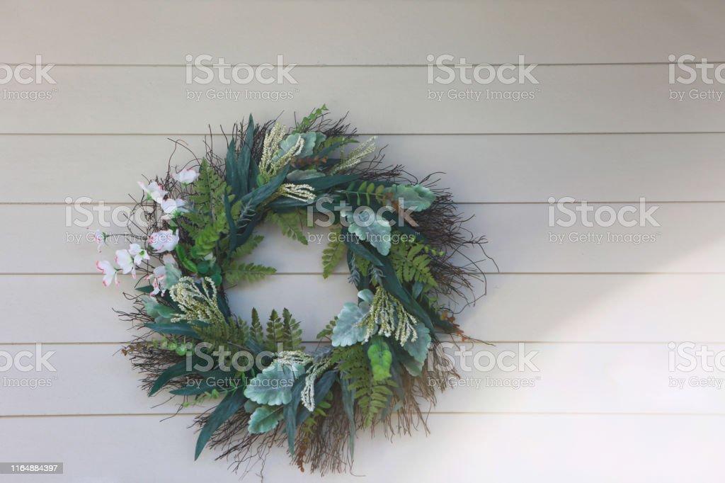 green wreath shiplap wall