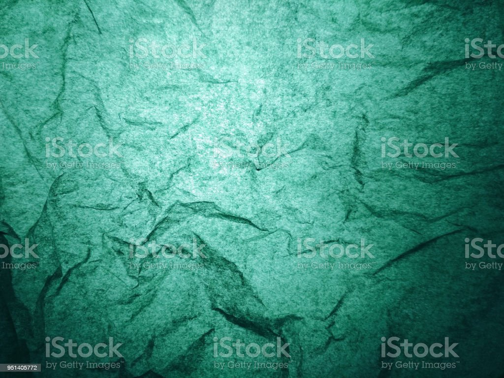 Green wrinkled paper light abstract texture background pattern stock photo