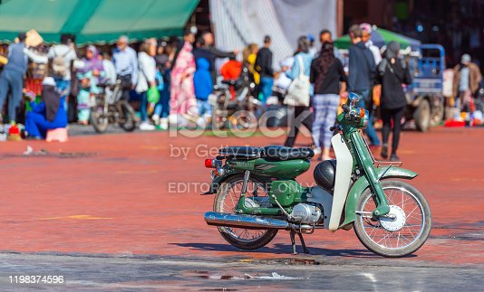 Marrakesh, Morocco - November 15, 2019: Green Yamaha motorcycle in a city square. With selective focus