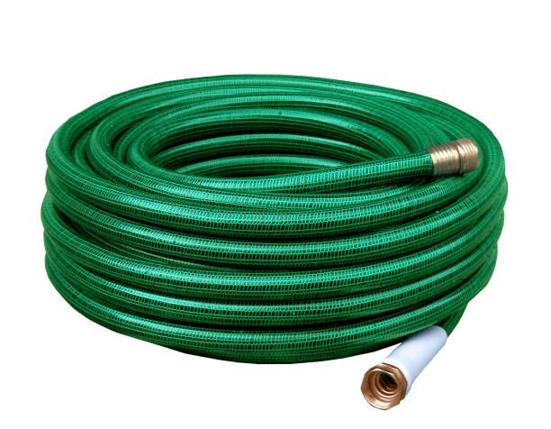 green yard hose coiled up for storage - garden hose stock pictures, royalty-free photos & images