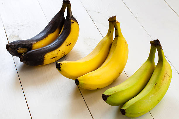 green, yellow and black bananas. - ripe stock photos and pictures