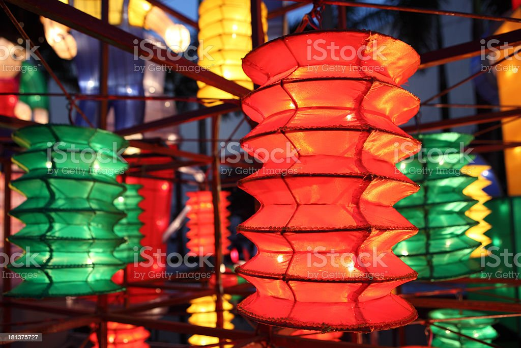 Green, yellow and red lanterns at a mid-autumn festival royalty-free stock photo