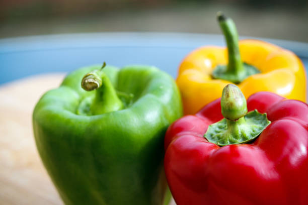 Green, yellow and red pepper stock photo