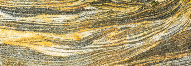 green, yellow, grey sedimentary rocks - colourful rock layers formed through cementation and deposition - abstract graphic design backgrounds, patterns, textures - deposition stock pictures, royalty-free photos & images