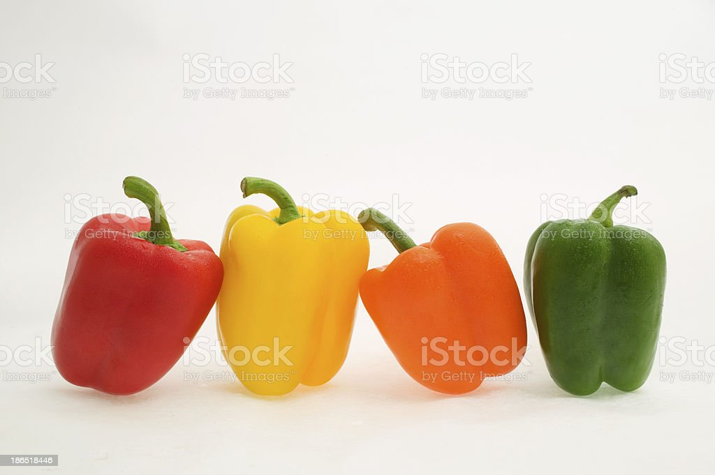 Green, yellow, orange and red peppers royalty-free stock photo