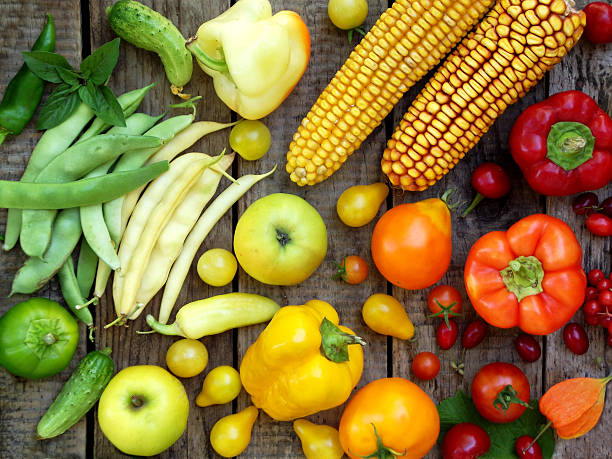 green, yellow, red fruits and vegetables stock photo