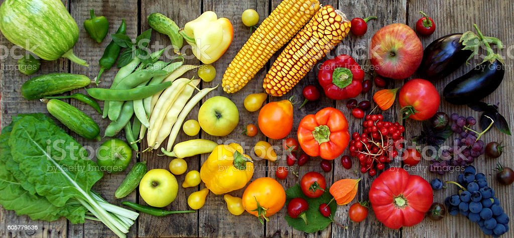 green, yellow, red, purple fruits and vegetables stock photo