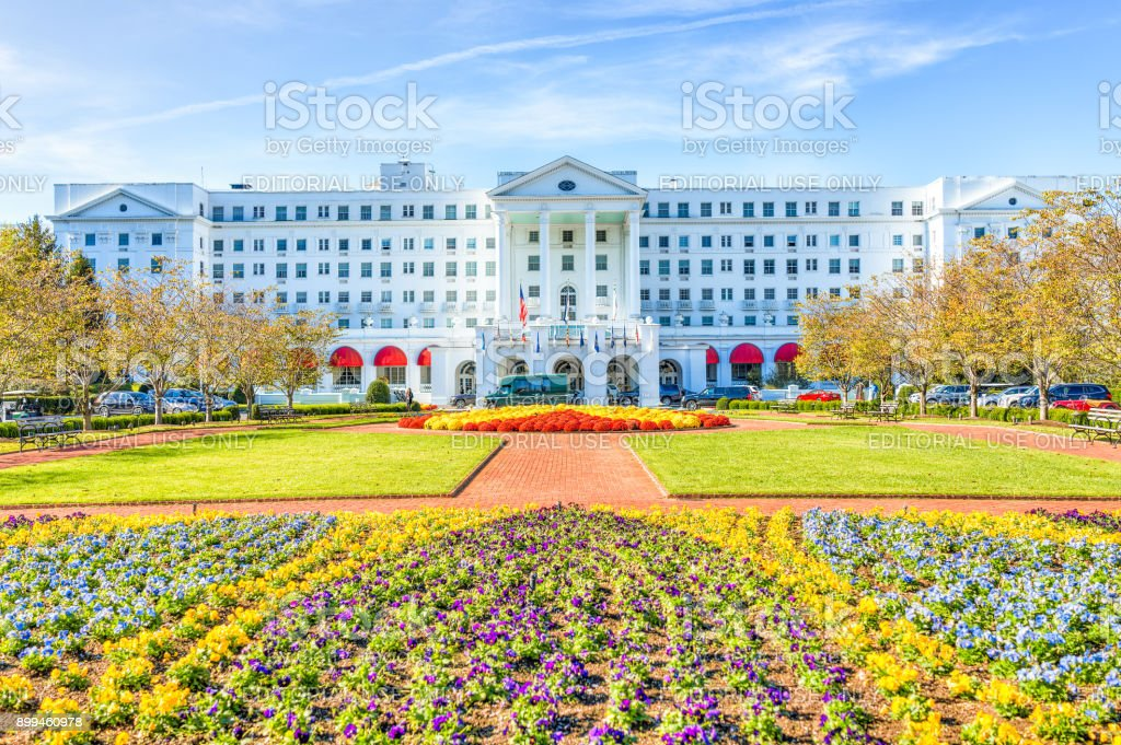 Greenbrier Hotel exterior entrance with landscaped flowers, cars, in West Virginia stock photo