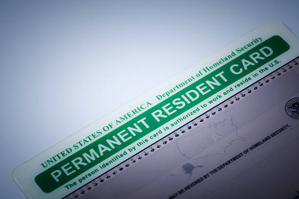 USA greencard Las Vegas, USA - August 30, 2016: An editorial stock photo of a Permeant Resident Card also known as Green Card. Photographed using the Canon EOS 5DSR and the Canon 100mm f2.8 IS L lens.  green card stock pictures, royalty-free photos & images
