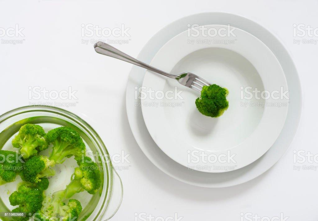 Greenery of fresh broccoli in a salad bowl stock photo