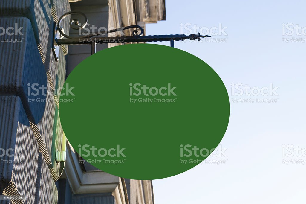 Greenery oval shape signboard on wall. Mock up. stock photo