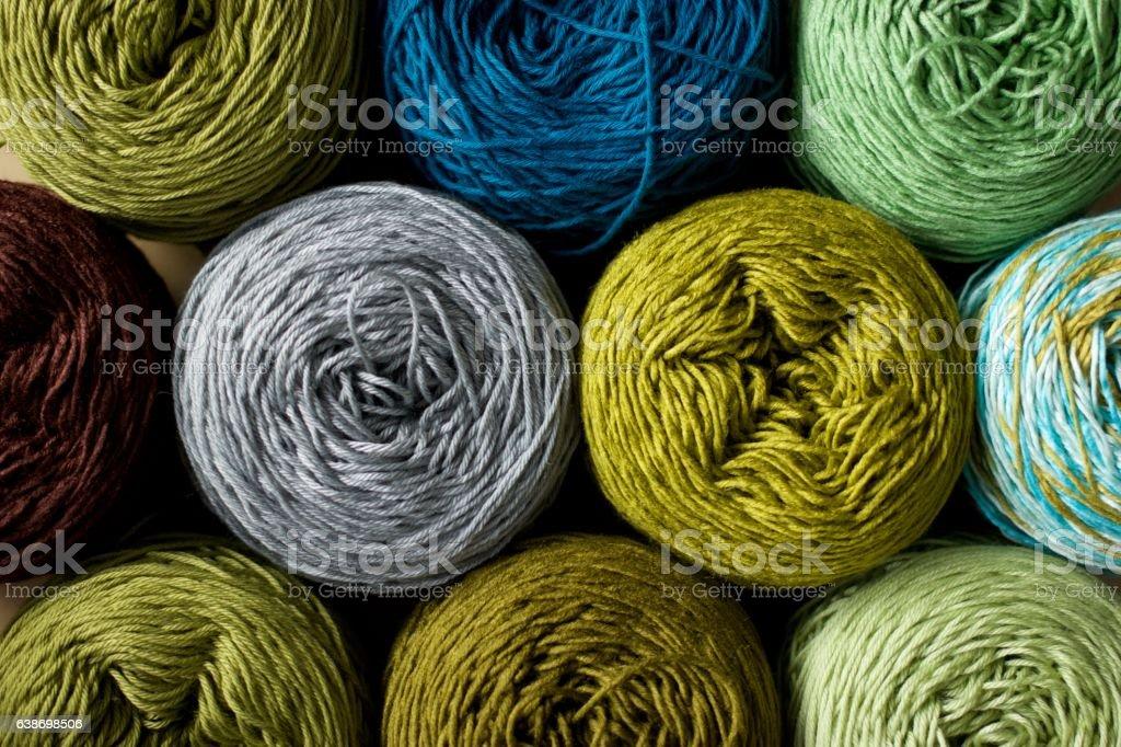 Greenery tone Balls wool cotton silk yarn set top view stock photo