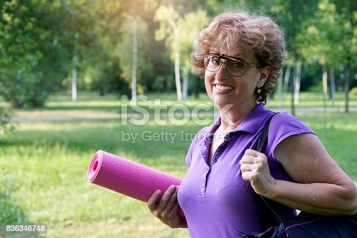 istock Greenery with an active senior woman 836346748