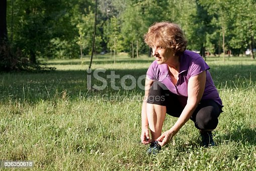 istock Greenery with an active senior woman 836350618
