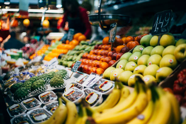 Greengrocer at public market La Boqueria Barcelona Greengrocer at public market La Boqueria Barcelona grocer stock pictures, royalty-free photos & images