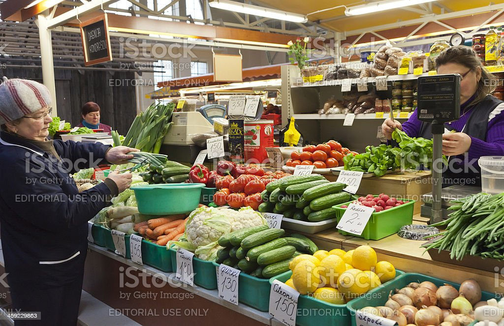 Greengrocer in Riga Central Market, Latvia royalty-free stock photo