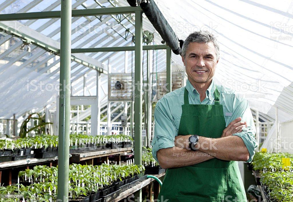 greenhouse gardener posing for camera royalty-free stock photo