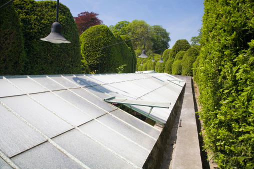 Greenhouse In English Garden Stock Photo - Download Image Now