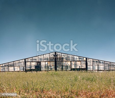 istock greenhouse in field, architecture of building exterior 478345658