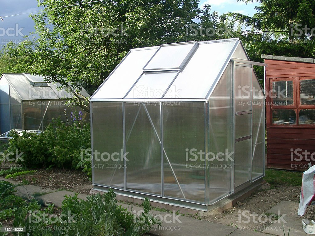 greenhouse in garden royalty-free stock photo
