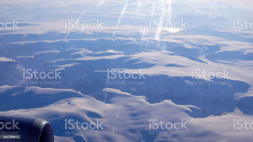 Greenland as seen from the sky, wing view with airplane stock photo
