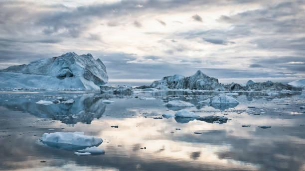 Greenland Icebergs Sunset Cloudscape Panorama stock photo