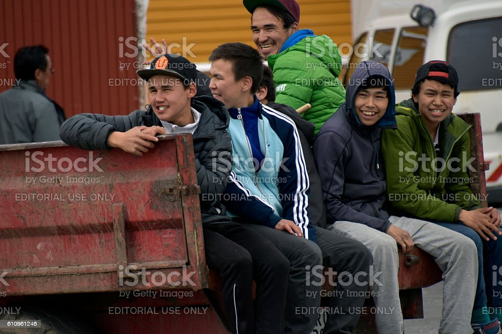 Greenlandic Inuit young man and boys stock photo