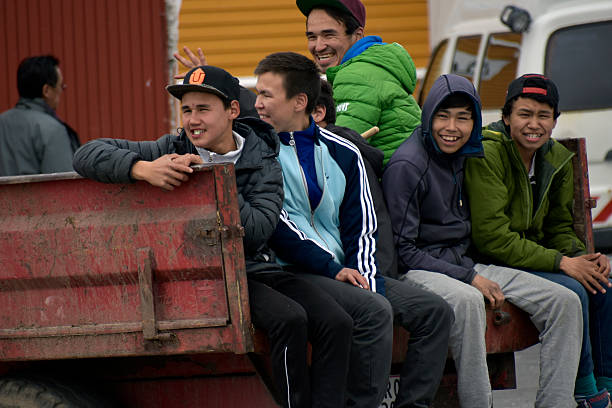 Greenlandic Inuit young man and boys – Foto