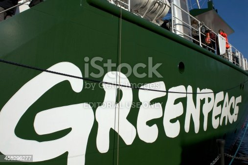 London, United Kingdom - November 13 2011: Rainbow Warrior III name and logo on side of Greenpeace's ship with members of the public visiting it on its open day in London.