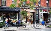 Greenpoint, NY: Millennials relax at outdoor tables at an eatery on Franklin Street in downtown Greenpoint, Brooklyn, NY.