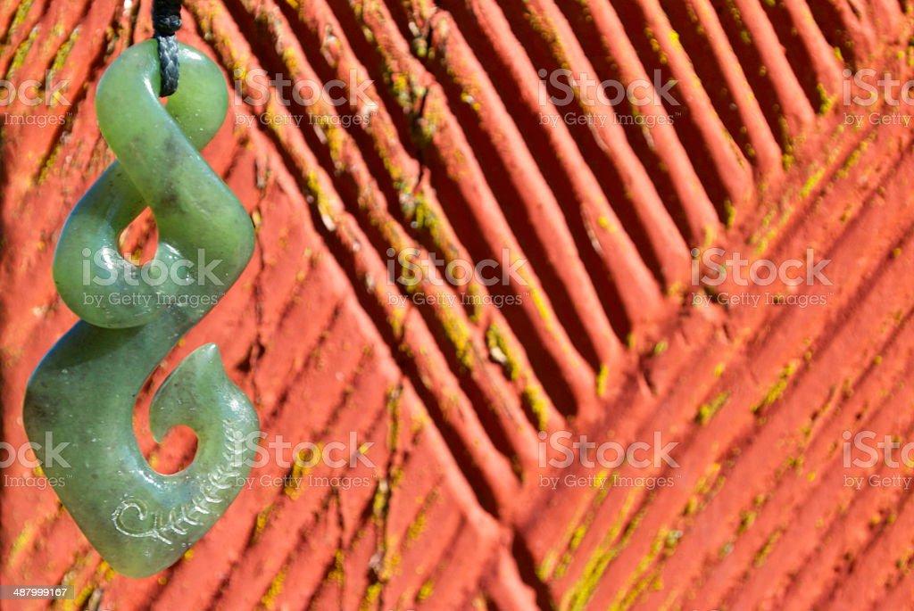 Greenstone (Pounamu) Double Twist Fish Hook Pendant royalty-free stock photo