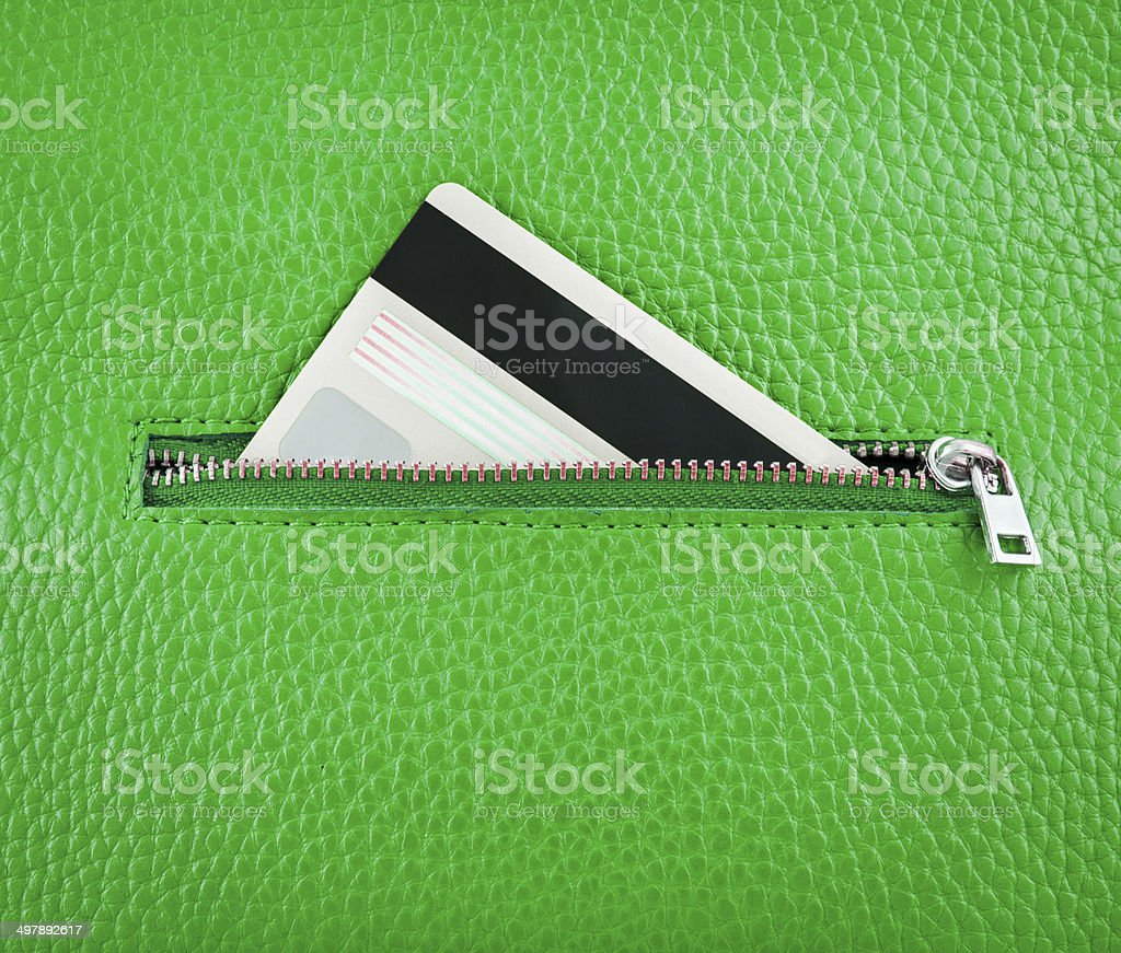 GreenUnzip leather wallet with card. stock photo