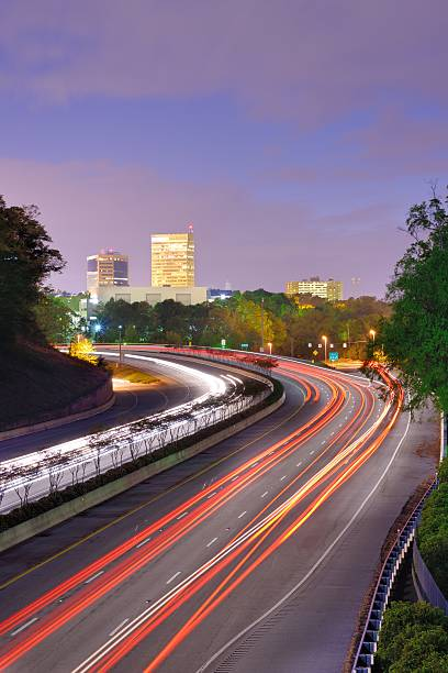 Greenville South Carolina Greenville, South Carolina skyline above the flow of traffic on Interstate 385. spartanburg stock pictures, royalty-free photos & images