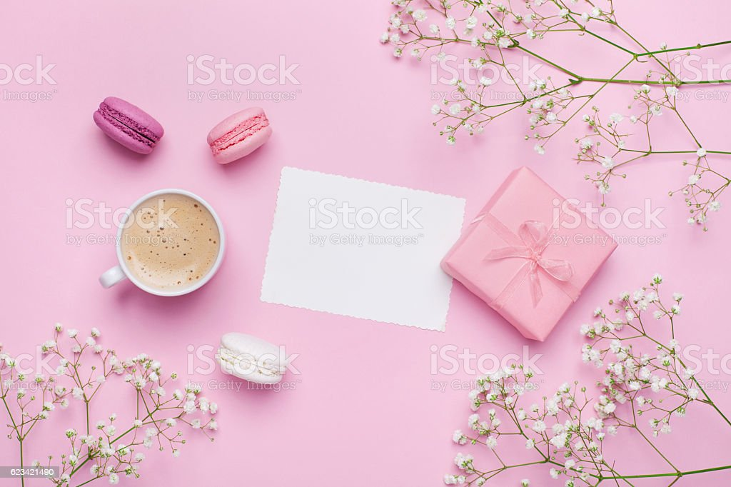 Greeting card concept. Coffee with macarons. Flat lay. Vintage mockup. stock photo