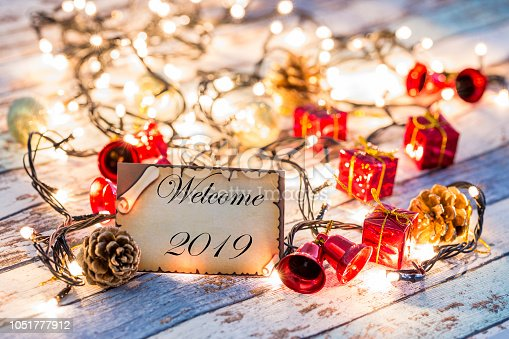 istock Greeting card for new year or christmas with Christmas lights and decorations 1051777912