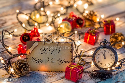 istock Greeting card for new year or christmas with Christmas lights and decors 1051781414