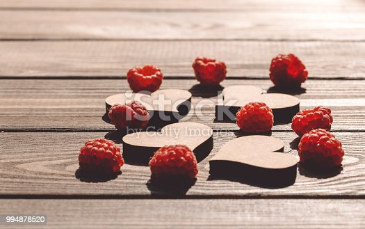 914465180 istock photo Greeting card. Hearts and raspberries 994878520