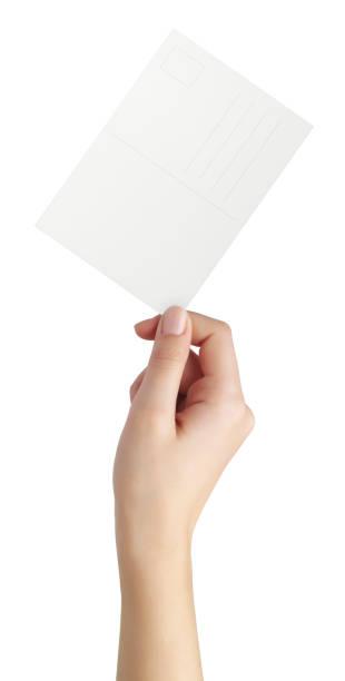 tarjeta de felicitación en mujer mano - postal worker fotografías e imágenes de stock