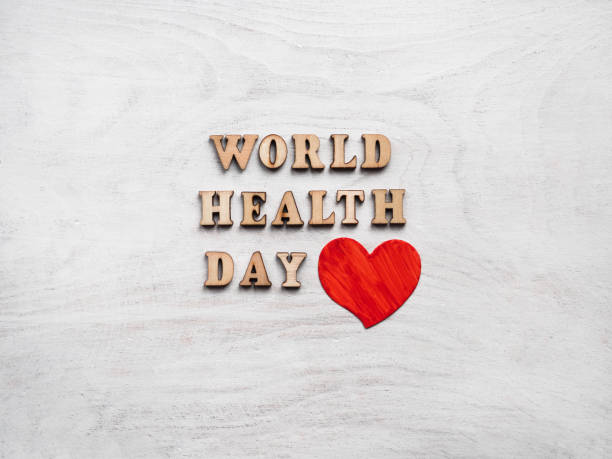 WORLD HEALTH DAY. Greeting card. Isolated background Wooden letters of the alphabet in the form of the words WORLD HEALTH DAY lying on a white table. Beautiful card. Isolated background, wooden surface. Congratulations for relatives, friends, colleagues world health day stock pictures, royalty-free photos & images