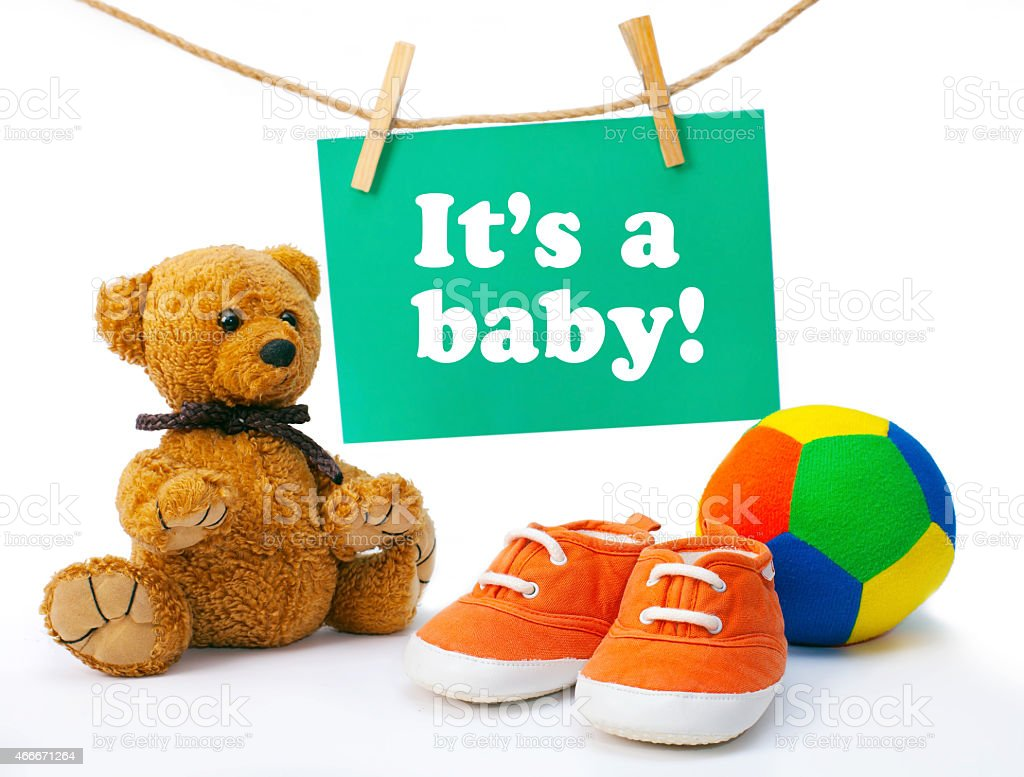 Greeting card it's a baby, tedy bear, baby's sneakers, colorful stock photo