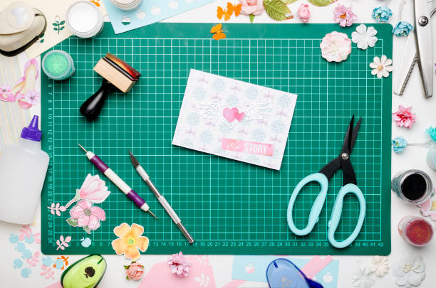 greeting card on green cutting mat, scrapbooking tools and materials - foto stock
