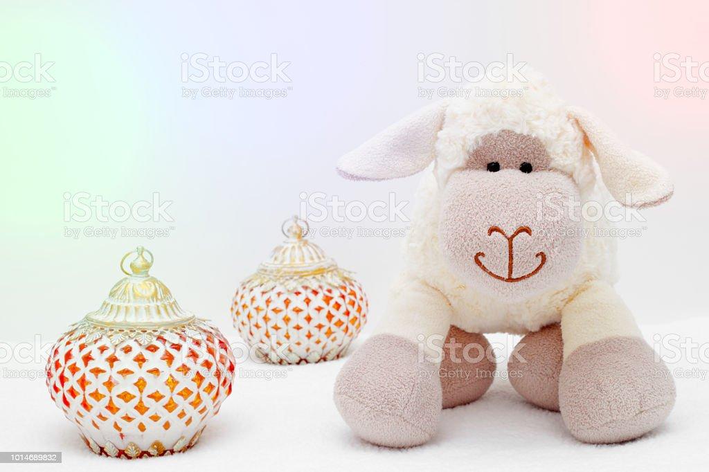 Greeting card on white background. Eid Al Adha sacrifice festival, Islamic Arabic candle and sheep. stock photo