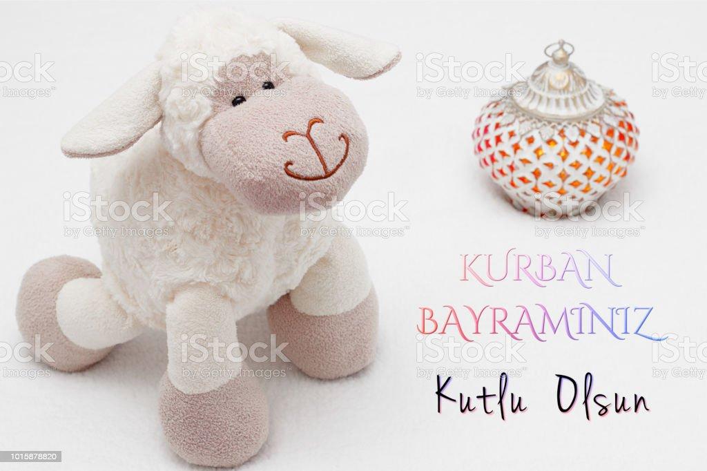 Greeting card on white background. Eid Al Adha sacrifice festival, Islamic Arabic candle and sheep. Kurban bayramnz kutlu olsun means happy festival of sacrifices stock photo