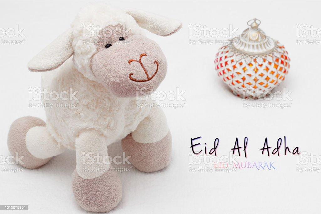 Greeting card on white background. Eid Al Adha sacrifice festival, Islamic Arabic candle and sheep. Eid al adha eid mubarak means happy festival of sacrifices stock photo