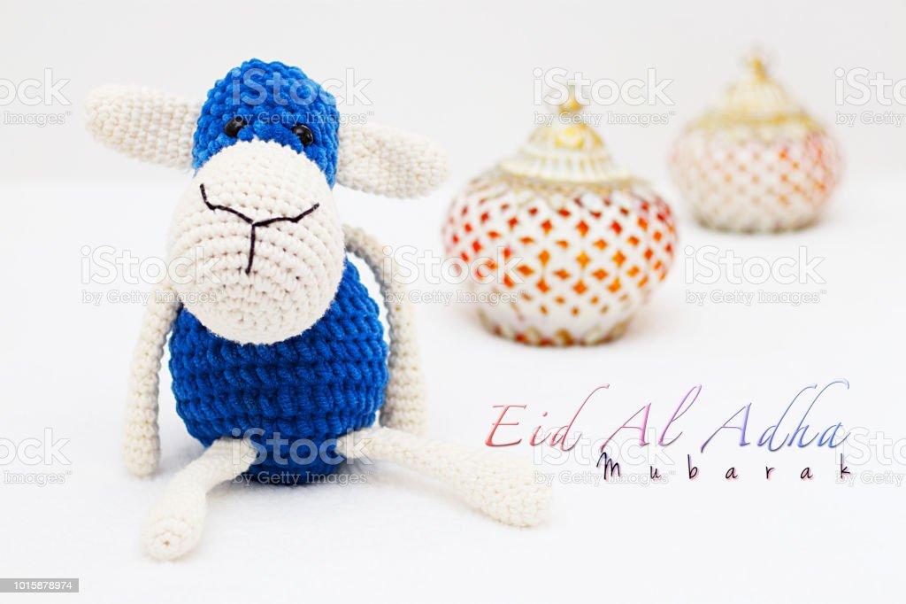 Greeting card on white background. Eid Al Adha sacrifice festival, Islamic Arabic candle and sheep. Eid al adha mubarak means happy festival of sacrifices stock photo