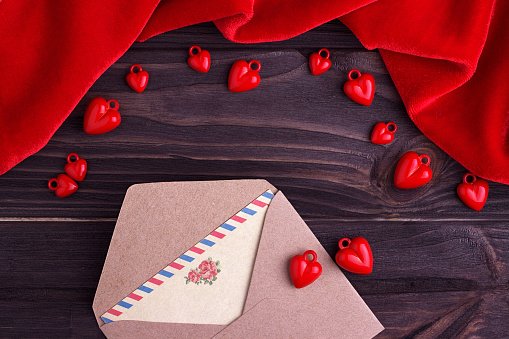 greeting card with a red heart and space for text on a brown wooden background